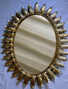 miroir à décor de feuilles dorés