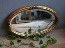 Miroir ovale biseauté ancien