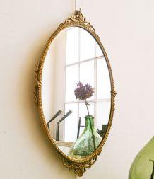 Miroir ovale ancien en métal doré