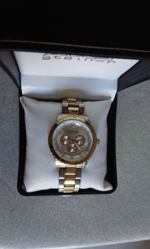 Montre August Steiner homme argent & or comme neuf