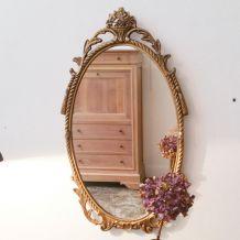Miroir ancien ovale bronze doré